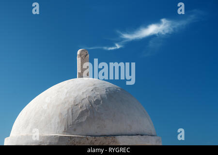 The top of a domed section along the old town city walls with wispy clouds in the background on a sunny summer's day, Dubrovnik, Croatia - Stock Photo