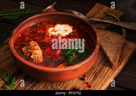 Traditional Ukrainian Russian red soup borscht with meat and sour cream. Selective focus - Stock Photo