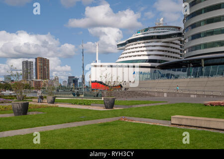 Ultramodern cruise ship AIDAperla is docked in Rotterdam at the cruise terminal. - Stock Photo