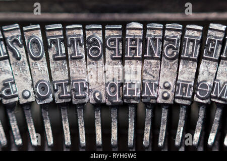 Hammers with letters, numbers and punctuation. Internal structure of the old Soviet typewriter close-up. - Stock Photo