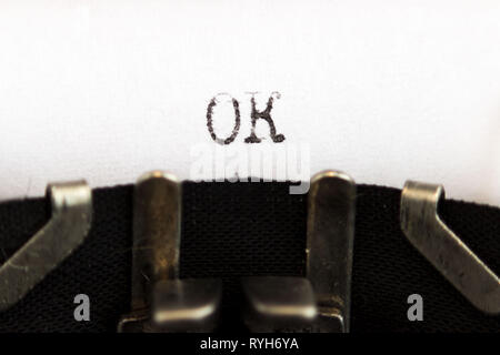 Old soviet typewriter close up. Filled in it blank sheet of paper with the word OK. Macro - Stock Photo
