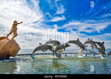 Mazatlan, Mexico-10 December, 2018: Dolphin Statue located on scenic Mazatlan Promenade (Malecon) near the ocean shore and historic city center - Stock Photo