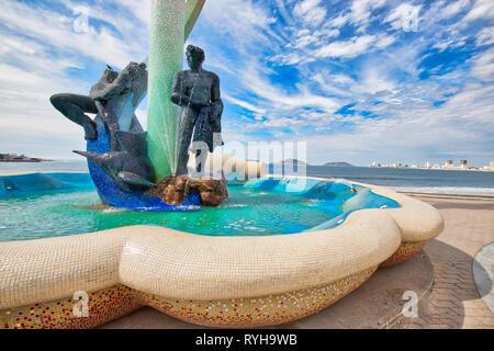 Mazatlan, Mexico-10 December, 2018: A Fishermen monument (Monumento al Pescador) located on scenic Mazatlan Promenade (Malecon) near the ocean shore a - Stock Photo