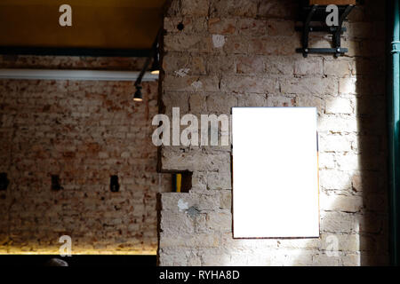 Blank ad space on a concrete wall of a building inside a bar - Stock Photo