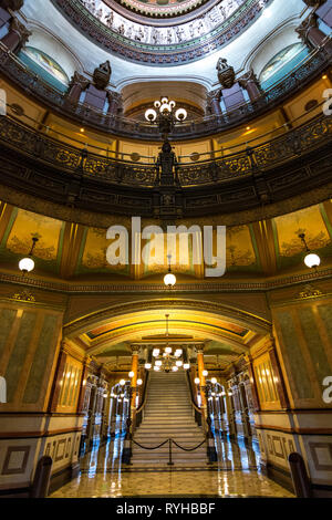 SPRINGFIELD, IL/USA - MARCH 10, 2019: Inside the beautifully ornate rotunda within the state capitol building as light enters through the stained glas - Stock Photo