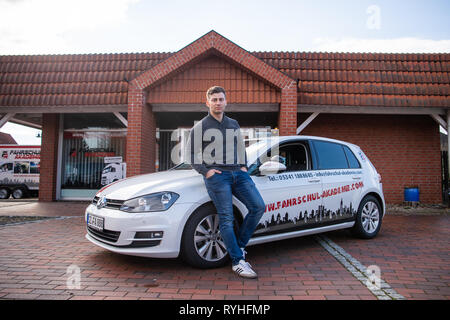 Lengede, Germany. 05th Mar, 2019. Tom Gerhard Tiessen, head of the A and G Driving Academy, stands in front of a driving school car. The European Court of Justice (ECJ) will decide on 14.03.2019 whether driving schools will be exempted from VAT. Tiessen had initiated the proceedings. Credit: Christophe Gateau/dpa/Alamy Live News - Stock Photo