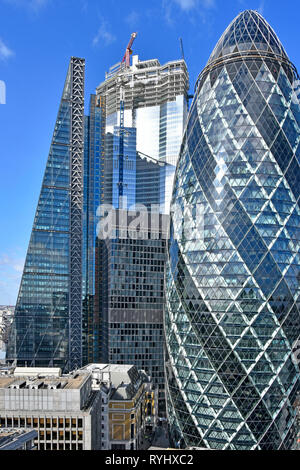 City of London skyline cityscape the Pinnacle skyscraper building under construction  between nearby landmarks Leadenhall Building & Gherkin London UK - Stock Photo