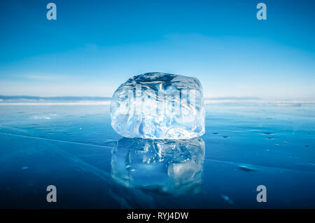 Close-up of natural breaking ice in frozen water on Lake Baikal, Siberia, Russia. - Stock Photo