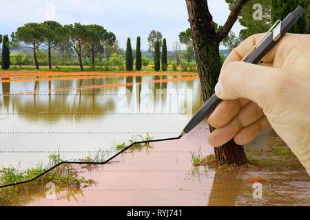 Hand draws a graph about seasonal rainfall - concept image - Stock Photo