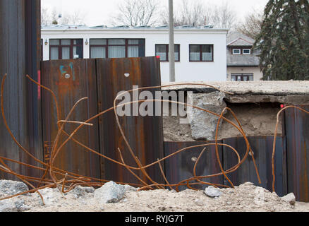 Steel pillar hitting in the ground to stabilizes the flood protection dam - Stock Photo