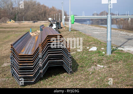 Steel construction pillars with specific shapes to stabilizes the flood protection dam - Stock Photo