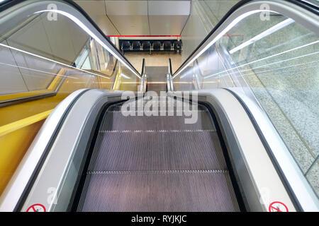 Escalator at Geneva airport.  Geneva. Switzerland. - Stock Photo