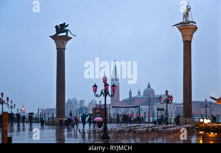 Italy, Veneto, Venice, After sunset lights of a rainy day in Piazza San Marco - Stock Photo