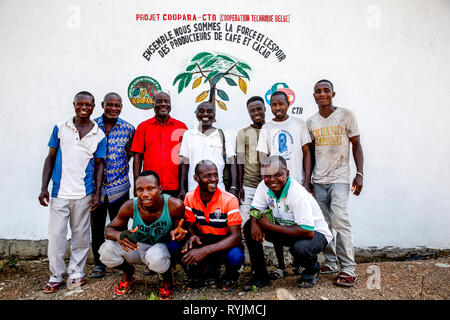 Cocoa planters' cooperative members in a village near Agboville, Ivory Coast. - Stock Photo