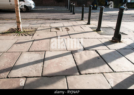 Old stone paving slabs remain in parts of Preston City Centre - Stock Photo