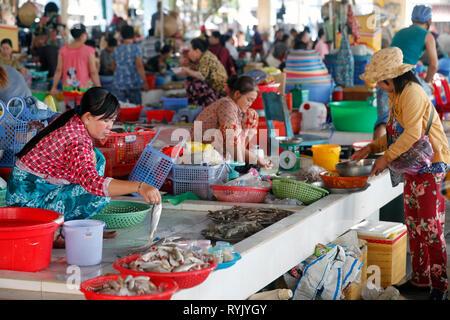 Fish market.  Women selling fresh fish.  Ha Tien. Vietnam. - Stock Photo