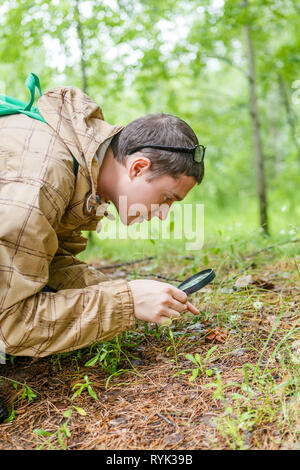 Picture of man with magnifying glass - Stock Photo