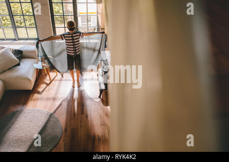 Boy pretending to a bat superhero. Boy playing in Bat costume at home. - Stock Photo
