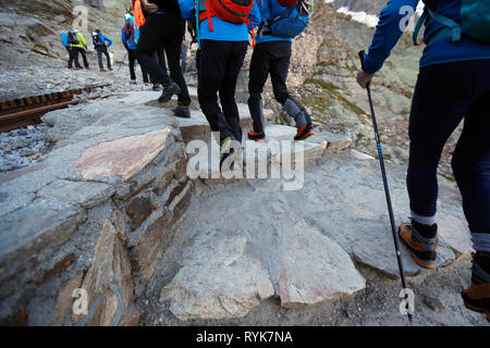 Alpinists during the ascent of Mont Blanc along the regular route via Gouter Refuge.   France. - Stock Photo
