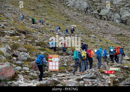 Alpinists during the ascent of Mont Blanc along the regular route via Gouter Refuge.  Local Bye-Law. Regulated Access to Mont Blanc sign.  France. - Stock Photo