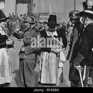 Nazism / National Socialism, politics, annexation of Austria 1938, march-in of the German Wehrmacht, welcoming of soldiers with schnaps, Innsbruck, Austria, 12.3.1938, Additional-Rights-Clearance-Info-Not-Available - Stock Photo