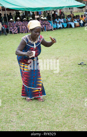 Anekro, ivory coast- August 20, 2015: an old woman dance a traditional dance of their region. The Ivory coast has 18 regions - Stock Photo
