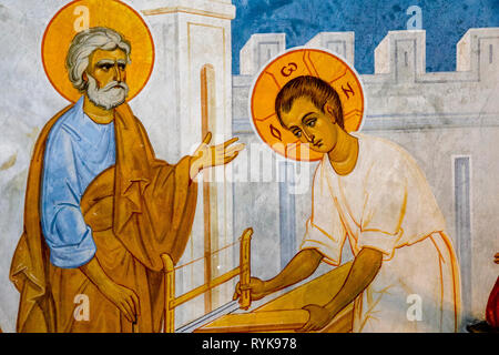 Detail of a fresco in the Greek orthodox church of the Annunciation, Nazareth, Israel. Jesus in St Joseph's carpentry workshop. - Stock Photo
