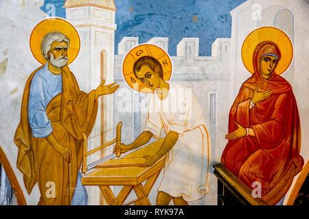 Fresco in the Greek orthodox church of the Annunciation, Nazareth, Israel. Jesus in St Joseph's carpentry workshop. - Stock Photo