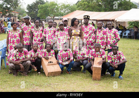 Anekro, ivory coast- August 20, 2015: Traditional music group invited for benefits. Loincloth dressed in uniform, some are squatting with their music  - Stock Photo