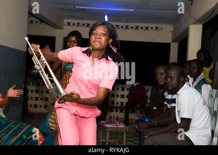 Anekro, ivory coast – August 20, 2015: a young , saxophone in hand performs dances in the king's court of the region - Stock Photo