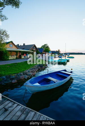 Boat on the Galve Lake in Trakai in Lithuania at sunset. - Stock Photo