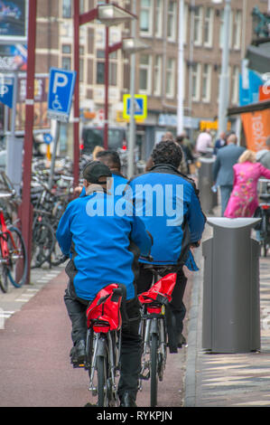 FedEx Van At Amsterdam East The Netherlands 2018 On Bicycles - Stock Photo