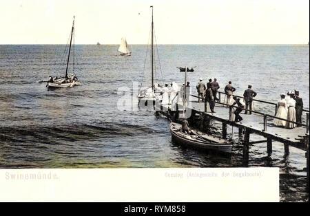 Piers in Poland, Sailboats in Poland, Old, Świnoujście, 1903, West Pomeranian Voivodeship, Swinemünde, Seesteg mit Menschen, Segelboote - Stock Photo