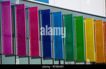 Colorful louvers background. Different rainbow color windows facade pattern of a modern building. Abstract blinds design and architecture concept. Off - Stock Photo