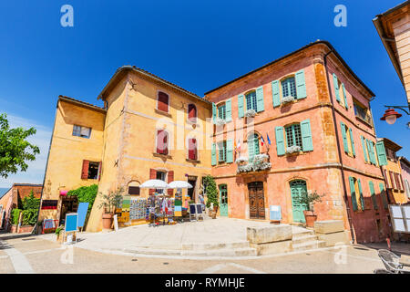 Provence, France. Traditional colorful houses in the Old Town of Roussillon. - Stock Photo