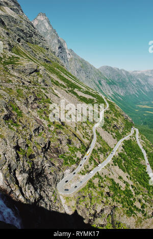 The zig zag Trollstigen mountain pass road on the Geiranger-Trollstigen National Scenic Route in Norway - Stock Photo