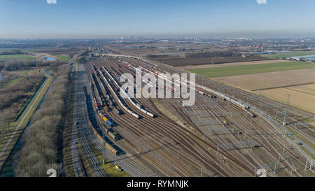 Cargo trains. Aerial view of colorful freight trains. Railway station. Wagons with goods on railroad. Heavy industry. Industrial scene with trains, ci - Stock Photo