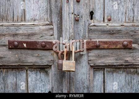 padlock on old wooden door - Stock Photo