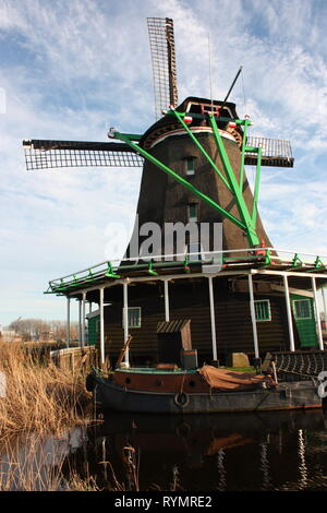 Dutch ancient windmill built from wood. typical structure of the Netherlands. old work tools on the river in the village of Zaanse Schans - Stock Photo