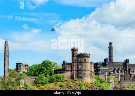Calton Hill with Political Martyrs Monument on Old Calton Burial Ground, Dugald Stewart Monument, Saint Andrew House and tower of Nelson Monument in E - Stock Photo