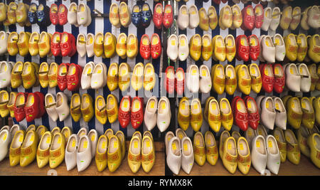 Rows of painted wooden shoes in various colors and sizes are displayed at an outdoor market selling Dutch souvenirs in Amsterdam in The Netherlands. Also called clogs or Klompen, the footwear dates back to medieval times in Holland and is still worn by a few people working in their gardens or on farms. While every town once had its own clog maker, these days there are only 12 left in the whole of the country. Because it takes 3 to 4 hours to make one pair of wooden shoes by hand, machines are now used to speed up the process. - Stock Photo