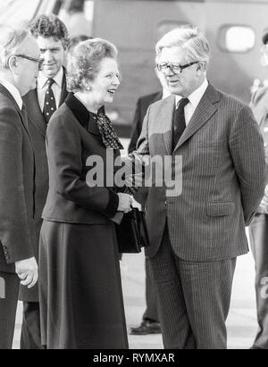 Prime minister Margaret Thatcher leaving London's Heathrow to Moscow with Foreign secretary Geoffrey Howe. - Stock Photo