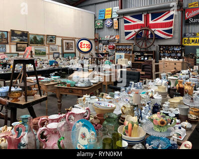 Antiques Market or Junk Shop full of old items for sale. - Stock Photo