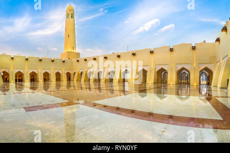 Doha, Qatar - February 21, 2019: panoramic courtyard with minaret and domes reflecting at blue hour. Imam Abdul Wahhab Mosque or Qatar State Mosque in - Stock Photo