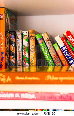 Poznan, Poland - November 18, 2018: Row of colorful child books in Polish on a shelf. - Stock Photo