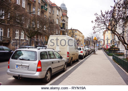 Poznan, Poland - March 8, 2019: Parked Opel Astra by a sidewalk on the Slowackiego street. - Stock Photo