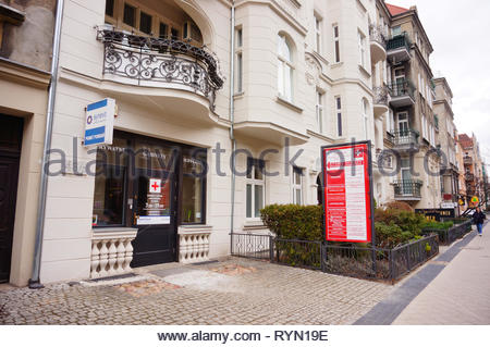 Poznan, Poland - March 8, 2019: Synevo medical office entrance in a apartment building on the Slowackiego street. - Stock Photo