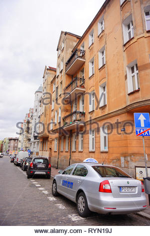 Poznan, Poland - March 8, 2019: Parked Skoda taxi car on special parking places on the Prusa street. - Stock Photo