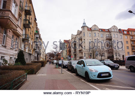 Poznan, Poland - March 8, 2019: Row of parked cars including Citroen on the Slowackiego street in the city center. - Stock Photo