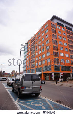 Poznan, Poland - March 8, 2019: Parked Volkswagen Transporter on a disability parking near the Globis office building. - Stock Photo